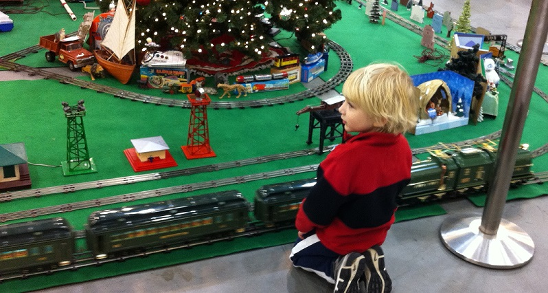 A young boy watches the operating trains at the Cal-Stewart Southern California Train Meet